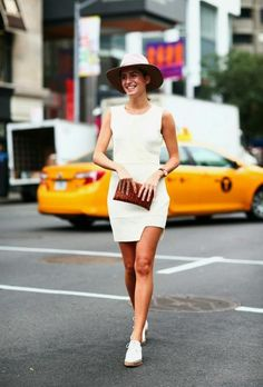 What to Wear With a Little White Dress - Bodycon, minimalist white mini dress with an asymmetric hem, styled with a chic hat + cool white sneakers