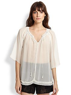 Alice + Olivia Mapton Crocheted-Trim Sheer Chiffon Blouse | Delicate, open-knit crocheted trim perfects the quiet bohemian chic of this romantic, flowing sheer chiffon peasant blouse.