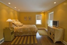 This bedroom uses yellow as its main colour scheme. Yellow can be stimulating as it is playful and reminds most people of sunshine and a warm afternoon. When looking at this room, there is a sense of artificial warmth and luxury. Makes the room more appealing in that sense.