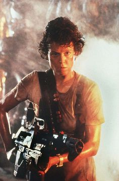 Sigourney Weaver as Ellen Ripley in the Alien series. I'm sorry, but I can't think of another woman who looks as bad ass covered in sweat and slime and blood as she does.
