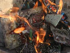 Irresponsible method of disposing E waste Components