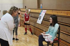 """Gretchen Gordon presents her research on Anne Frank at Gilbert Intermediate School on Thursday. Students were asked to research historic figures and on Thursday, they got to dress up as their figure at a """"live wax museum"""" and give their presentations in front of parents and other students. Photo by Julie Erickson/Ames Tribune   http://amestrib.com/news/history-comes-alive-gilbert-intermediate"""
