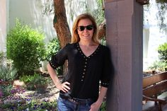 Rosie of Round and Round Rosie could not look cooler in this awesome black studded blouse from her last Fix. Those hot shades complete the outfit!