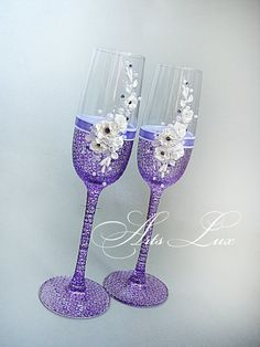 Very tender and charming Wedding champagne glasses in violet decorated with Swarovski stones