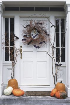 It doesn't get easier than this: Simply add felt bats to a natural twig wreath to give trick-or-treaters a friendly fright.
