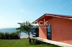 Kiwi Bach by the Beach Royalty Free Stock Photo Kiwiana, Beach Photos, Image Now, Royalty Free Stock Photos, Building, Places, Outdoor Decor, Holiday, Summer