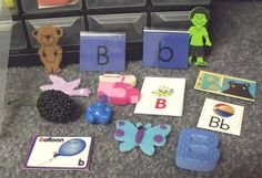 Alphabet box- one drawer for each letter-I would label each drawer with a letter sticker