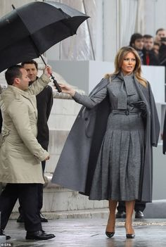 First Lady Melania Trump looked the picture of elegance in a grey wool pleated dress, teamed with an overcoat in the same shade as she attended the international ceremony for the Centenary of the WWI Armistice of 11 November 1918 in Paris Hijab Fashion, Fashion Outfits, Womens Fashion, Ladies Fashion, Melanie Trump, Milania Trump Style, First Lady Melania Trump, Trump Melania, Royal Fashion