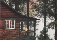 screen-porch in back facing lake; warm glow of lamp in corner // vintage lake, camp, cottage and cabin decor Table Vintage, Vintage Cabin, Lake Cabins, Cabins And Cottages, Cabin Homes, Log Homes, Cabin In The Woods, Mountain Cabin Decor, Lakeside Cottage