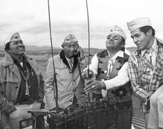 From left to right, Navajo Code Talkers Teddy Draper, Jimmie King, Judge Dean Wilson and Francis Thompson trying to increase the reception of their radio backpack. March 1975