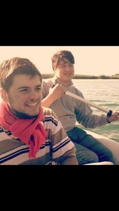 Older Marcus and Winston in a boat