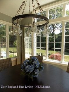 Yes!!!! yes!!!! love eveything about this room right down to curtain in corners!!!!     Kitchen sunroom dining space by New England Fine Living
