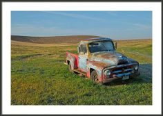 An abandoned truck with a colorful history basks in the early morning sun on the Palouse, outside of Spokane in Eastern Washington. Painted Pony On The Palouse Framed Print By Paul Presnail available in sizes to fit all spaces and Holiday budgets.
