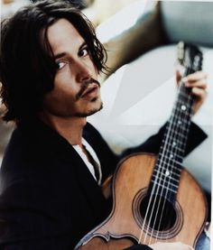 Johnny Depp...if he came knocking at my door it would be no questions, whether i was with someone or not!