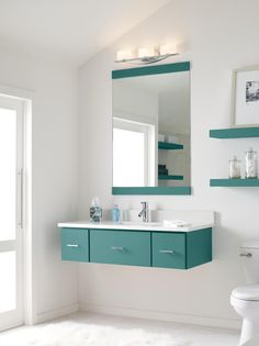 Make minimalist dreams come true with this Marquis-style floating Decora vanity in a cool Lagoon finish. #DecoraBathrooms