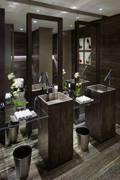 oooooh that sink!!!  beautiful  Contemporary, dark but clean Marble floors, stone pedestals, glass shelves