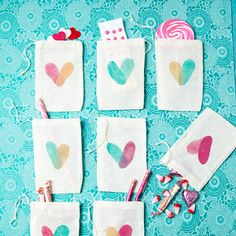 Decorate candy pouches with thumb-print hearts for Valentine's Day treats.