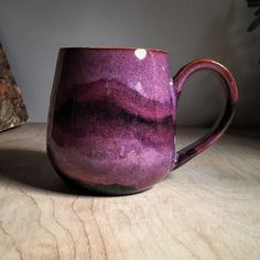 2x Smokey Merlot with band of Obsidian on buff stoneware fired to cone 6. By Amanda Joy Wells