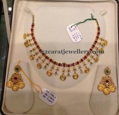 Jewellery Designs: Simple Ruby Set with Lakshmi Clasps