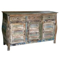 Mango wood sideboard with a weathered multicolor finish.