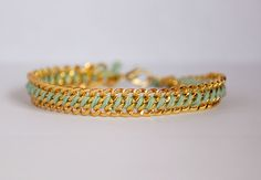 There are many variations of the woven chain bracelet. I had some left over chain and embroidery thread from previous projects, so I decided on a simple method to string two pieces of chain togethe…