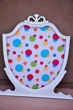 Turn a broken vanity mirror into a cute pin board: add corkboard behind and cover with fabric!
