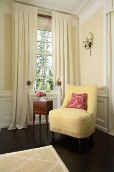 beautiful simplicity.....small buttons top these drapes....zoom in to see the delicate fringe on the soft yellow chair....so lovely