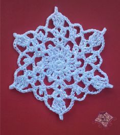 Crocheted snowflake (difficulty: medium. Needs very thin yarn.)