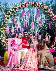 Pink Floral Mehendi Decor with bride in a peach silver mirror work lehenga. Desi Wedding Decor, Wedding Decorations, Mirror Work Lehenga, Baroque Decor, Mehendi, Wedding Bells, Tulle, Peach, Bride