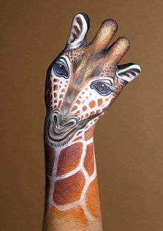 Italian artist Guido Daniele creates the most surreally brilliant portraits of wild animals using little more than body paint and a hyper-realistic imagination.