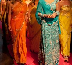 Beautiful saris - I've always wanted one of these.  Then I could have Bollywood Party!
