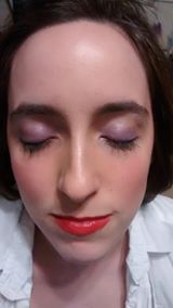 Makeup I did. I put on light purple shimmery eye shadow. Gave her a bold red lip, and some foundation. No eyeliner, kept it natural.