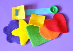 Button Snake.... She cut out felt shapes in rainbow colors to string onto the ribbon.  Once again, you could have your child sort by color, identify shapes, or make a pattern.