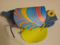 Paper bag insect with paper wings and pipe cleaner legs craft for Kindergarten.