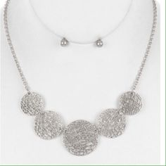 Mesh metal necklace and earring set Cutout mesh metal bib necklace and earring set. 16 inch long 1 1/4 inch drop. Jewelry Necklaces