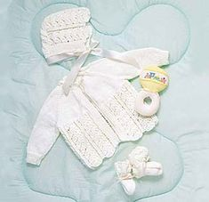 Gift this darling baby layette, knitted in Bernat Baby yarn. Crochet Baby Cardigan Free Pattern, Layette Pattern, Baby Sweater Patterns, Baby Knitting Patterns, Baby Patterns, Crocheting Patterns, Clothes Patterns, Knitting Stitches, Crochet Pattern