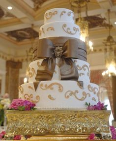This is a gorgeous wedding cake and yes of course that bow is edible...I think lol