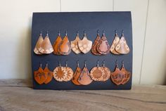 IN STOCK These unusual leather earrings are handcrafted in Australia using full grain vegetable tanned leather. They are hand cut, hand tooled and hand
