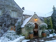 The entrance to Calcot Manor looking enchanting in the snow. A perfect winter wonderland.