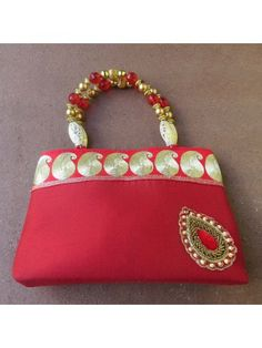 Buy Bright Red party bag! With embellished motif, paisley lace and beaded handle