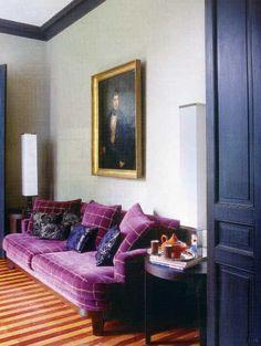 Purple sofa, purple cushions, purple paintwork.. red & yellow stripe floor!