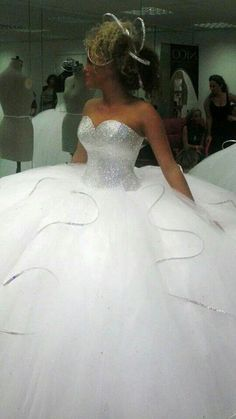 Don't care for the head piece but this dress is stunning.