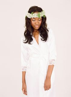 Studied simplicity of shape and silhouette combined with delicate cuffs of gentle lace makes this bridal robe a brides dream