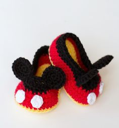 Make these adorably cute Mickey-Inspired Crochet Baby Booties for your expecting friend or sister! Learn how to crochet baby booties with this Disney-inspired crochet pattern that is as cute as a mouse. The loveable little baby you are crocheting for will look absolutely precious with a pair of homemade baby booties. DIY crochet baby booties make for some great DIY baby shower gift ideas. So, get your needle ready and crochet away with this squeak-worthy pattern!