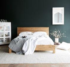 dark walls wooden bedframe