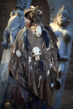 Africa | Dogon hunter wearing a traditional tunic; they display the skulls of…