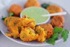 Easy South African Spicy Chilli Bites made from scratch with a few simple ingred… Easy South African Spicy Chilli Bites made from scratch with a few simple ingredients. The perfect Indian snack, crisp on the outside and soft in the inside Indian Snacks, Indian Food Recipes, Ethnic Recipes, Spicy Recipes, Curry Recipes, Vegetarian Cooking, Vegetarian Recipes, Easy Chilli, Veg Appetizers