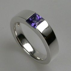 This is our Times Square 5 ring. A lovely unique women's ring which looks fabulous with any stone. Handmade in our London jewellery workshops in solid sterling silver with a variety of precious stone options including blue topaz, amethyst and garnet. Simply use the drop down menu to view your options.