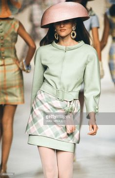 A model walks the runway at the Valentino Ready to Wear Spring/Summer 1991 fashion show during the Paris Fashion Week on October, 1990 in Paris, France. Fashion Show, Paris Fashion, Valentino Garavani, Ready To Wear, Runway, Walking, Mini Skirts, Spring Summer, Paris France
