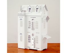 Kids will have a ball customizing a cardboard dollhouse.